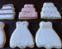Sugar cookie wedding dresses, cakes, and champagne glasses frosted in coral, chocolate brown and cream