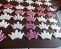 Sugar cookie crowns frosted in maroon, hot pink and white