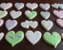 Sugar cookie hearts frosted in chartreuse, pink, gray and white