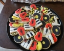 Sugar cookie red guitars, black and gold 8th notes and records, and piano keys