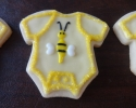 Sugar cookie onesies frosted in yellow
