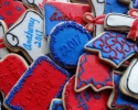 Sugar cookie graduation shapes frosted in blue and red