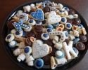 Chocolate Chip Cinnamon Strips - Chocolate Truffle Cups - Colored Thumbprints (navy and white) - Nut Horns - Strawberry Lilies - Sugar cookie Ks, Js, and hearts (navy and white)