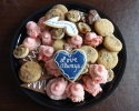 Dark Chocolate Espresso - Frosted Cherry - Peanut Butter and Chocolate Marbled - Pecan Tassies - Sugar cookie hearts and eighth notes frosted in navy and silver