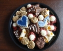 Apricot Meltaways - Chocolate with white chocolate chips - Pecan Tassies - Red Velvet - Sugar cookie hearts and eighth notes frosted in navy and silver