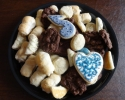 Chocolate and white chocolate chip - Lady locks - Orange Raspberry Turnovers - Sugar cookie hearts and eighth notes frosted in navy and silver - Vanilla Crinkles (navy and silver sugar)