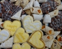 Apricot Meltaways - Chocolate Chip Cookies - Chocolate Shortbread - Lemon on lemon - Nut Horns - Sugar cookie hearts frosted in gold and white