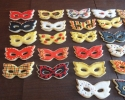 Sugar cookie Mardi Gras masks frosted in red, black, and gold