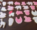 Sugar cookie baby shapes frosted in pink and white