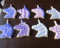 Sugar cookie unicorns frosted in purple and pink