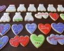 Sugar cookie hearts, wedding dresses and cakes frosted in pomegranate, lime, light and dark purple