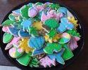 Sugar cookie beach cutouts frosted in green, blue, and pink
