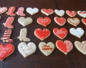 Sugar cookie hearts and cowboy boots frosted in red, beige and white
