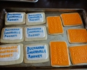 Sugar cookie plaques frosted in orange, white, and blue
