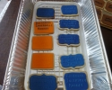 Sugar cookie plaques frosted in orange and blue