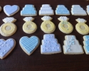 Sugar cookie hearts, wedding cakes, and engagement rings frosted in lilac and blue