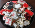 Sugar cookie graduation shapes frosted in red, white, and black