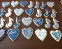 Sugar cookie hearts and eighth notes frosted in navy and silver