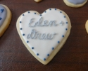 Sugar cookie heart frosted in navy and silver