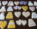 Sugar cookie wedding cutouts frosted in gold, ivory, cranberry and eggplant