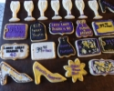 Sugar cookie champagne flutes, dresses, flowers, and heels frosted in black, gold and purple
