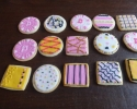 Sugar cookie squares and poker chips frosted in pink, black, white, and gold