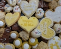 Chocolate Chip Cookies - Coconut Macaroons - Colored Thumbprints (gold and white) - Dark Chocolate Espresso Shortbread - Italian Knots (almond and anise) - Peanut Butter Cup Cookies - Sugar cookie hearts frosted in gold and white