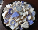 Sugar cookie wedding dresses, cakes, engagement rings and hearts frosted in silver and purple
