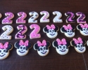 Sugar cookie Minnie Mouses and twos frosted in hot pink and black