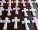 Sugar cookie crosses frosted in pink and white