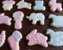 Sugar cookie baby feet, onesies, rocking horses, giraffes, bunnies, teddy bears, strollers, rattles, bibs, booties and elephants frosted in pink and blue