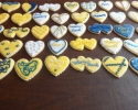 Sugar cookie hearts frosted in navy, gold, and white