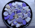 Sugar cookie champagne flutes, engagement rings, cakes, dresses, and hearts frosted in purple and gray