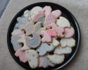 Sugar cookie baby feet, bibs, onesies, strollers and rocking horses frosted in pink and gray