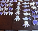 Sugar cookie zebras, octopi, and sharks frosted in purple and silver