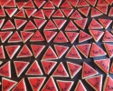 Sugar cookie triangles frosted in red and black