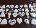 Sugar cookie hearts, champagne flutes, wedding dresses and cakes frosted in black and white