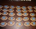 Sugar cookie footballs with Monmouth University logo
