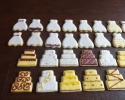 Sugar cookie wedding dresses and wedding cakes frosted in burgundy and gold