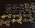 Sugar cookie bears, arrows and number ones, frosted in brown, yellow and green