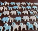 Sugar cookie lions, elephants, and giraffes frosted in blue and white