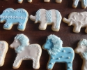 Sugar cookie lions and elephants frosted in blue and white