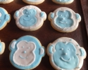 Sugar cookie monkeys frosted in blue and white