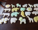 Safari animals frosted in ivory, gold, and mint