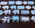 Sugar cookie elephants and shapes frosted in blue, white, gray, and black