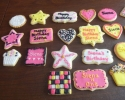 Sugar cookie stars, squares, rounds, placards, hearts, scalloped rounds and cupcakes frosted in black, white, hot pink and gold