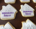 Sugar cookie houses with Sojourner House logo