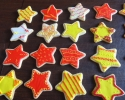 Sugar cookie stars frosted in red, yellow and white