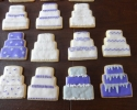 Sugar cookie wedding cakes frosted in purple and silver